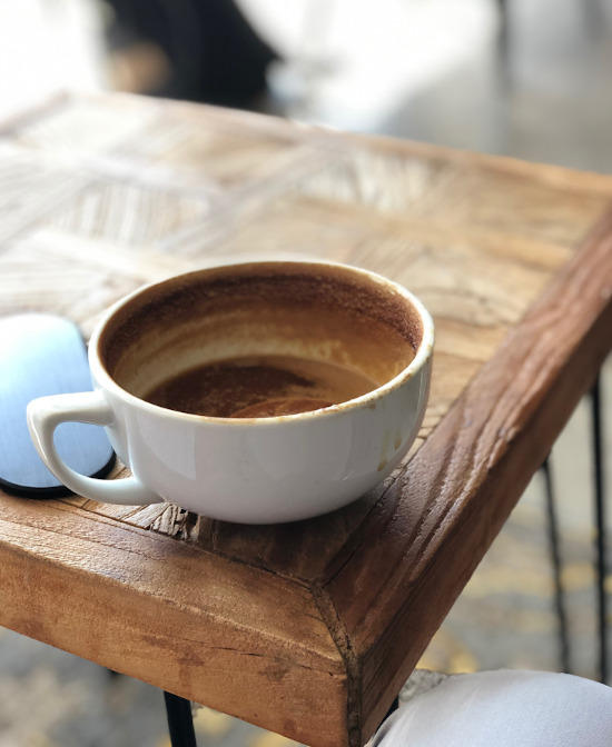 how to use less plastic - Almond milk latte in reusable cup