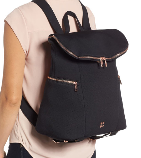 Stylish top opening back pack with gold tone zippers for extra style.