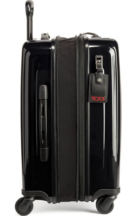 Hardside carryon with built in locking system and spinning wheels.