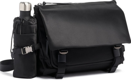 Stylish unisex gym bag with pockets for water bottle, shoes, and more.