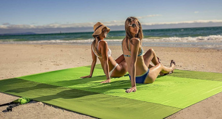 Large oversized blanket that is big enough for 7 people on the beach or at the park.