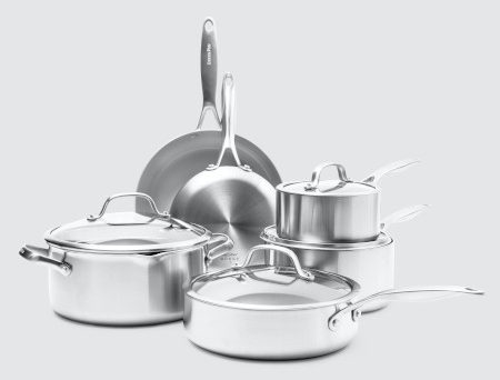 Pots and fry pans and lids in one stainless steel exterior set.