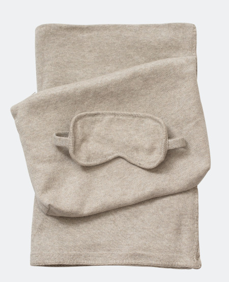 Stress free travel Includes a fine knit throw with a matching eye mask in a pouch.
