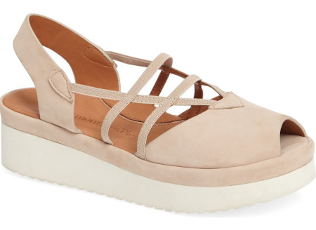 Cushioned footbed and slender elastic straps with fashionable styling.