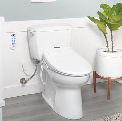 Luxury heated bidet fits existing toilet.