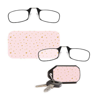 Nose clip readers with pink phone case or key ring case.